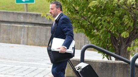 Steve Politi, attorney for Thomas Murphy, leaves Suffolk