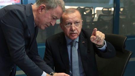 Turkish President Recep Tayyip Erdogan, right, with Defense