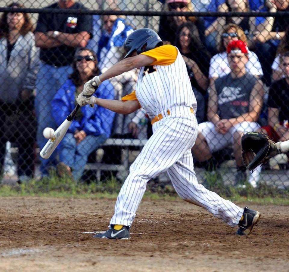Massapequa's Nick Comito hits a fly ball to