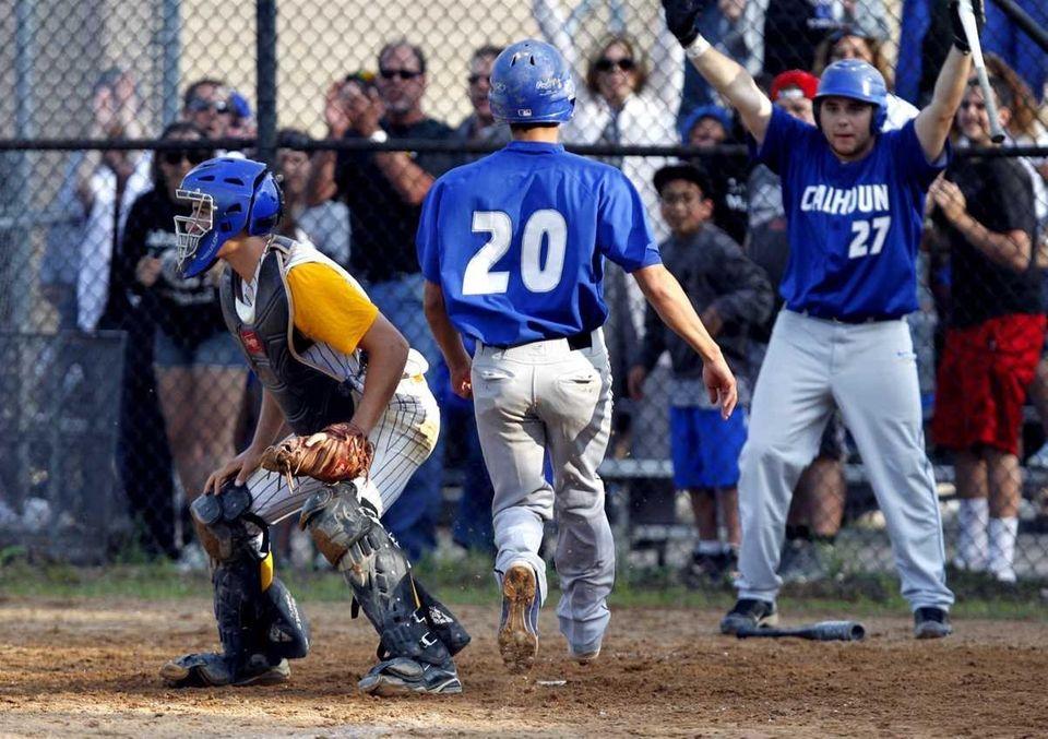 Calhoun's Zach Mastrangelo (20) scores on a sacrifice