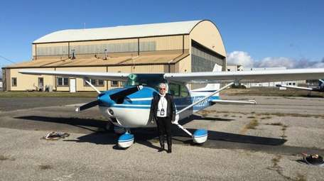 Grace Shoenemann stands next to her 1972 Cessna