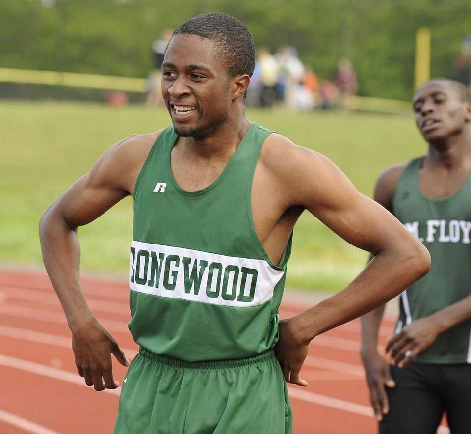 Longwood's Mark Jackson reacts after winning the 200