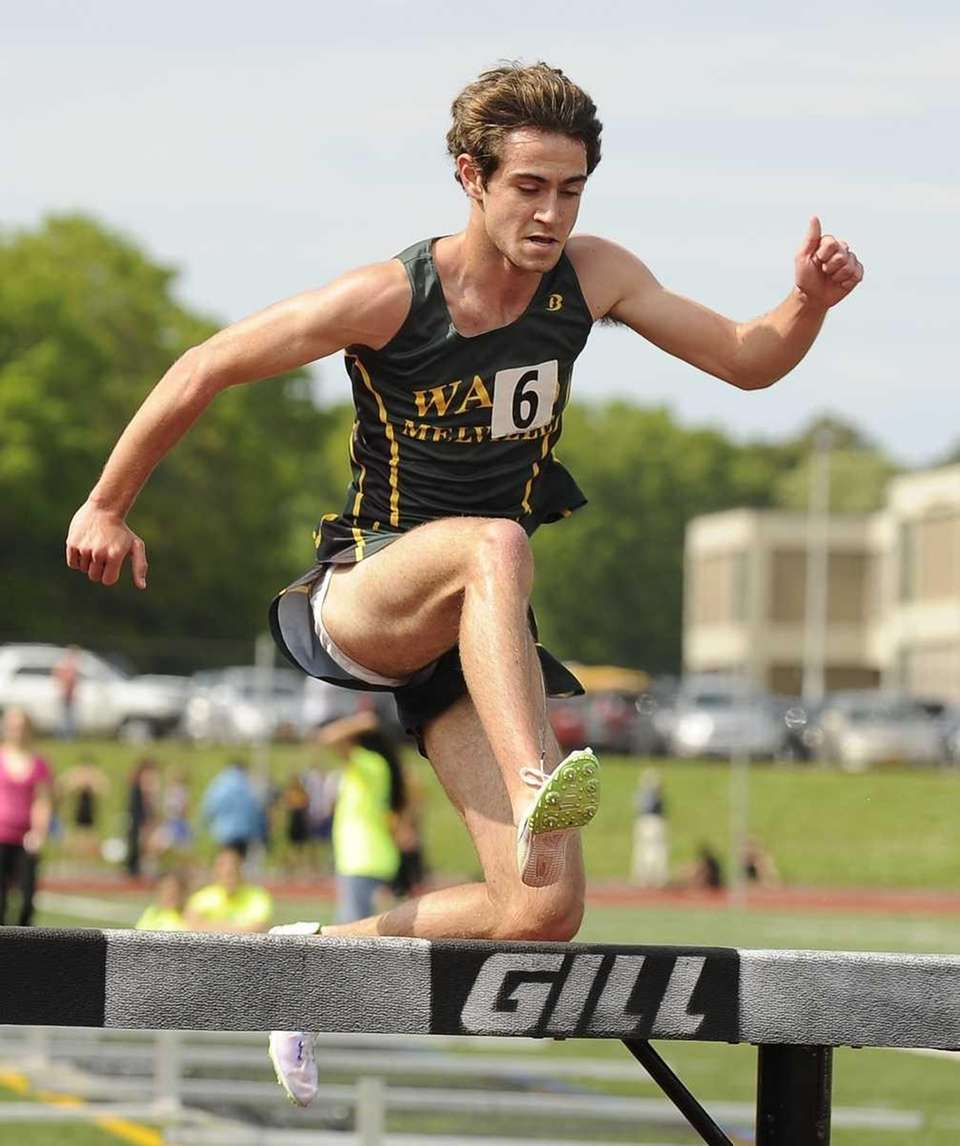 Ward Melville's Alex Fitzgerald clears a hurdle in