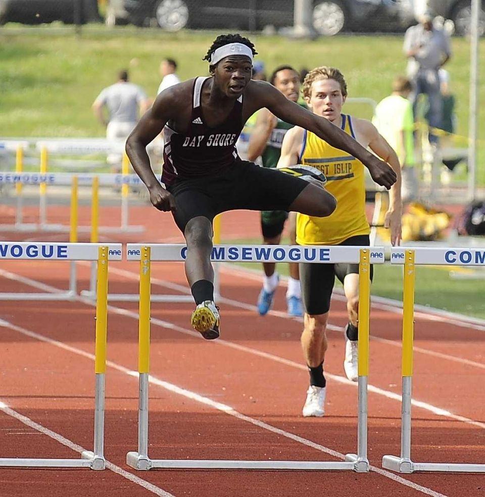 Bay Shore's Kadesh Roberts clears the last hurdle