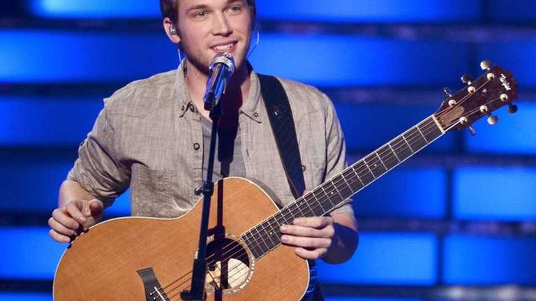 Phillip Phillips, the winner of season 11, performs