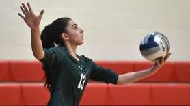 Danielle Farese #13 of Bellmore JFK serves during