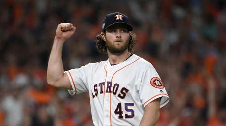 Houston Astros starting pitcher Gerrit Cole (45) reacts