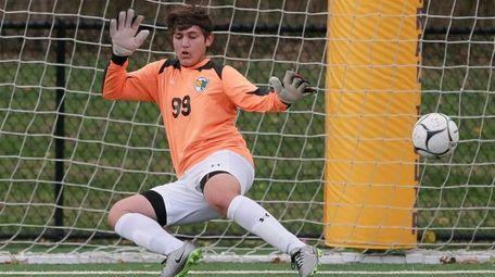 Ward Melville Goalie Jack Jesperson makes a save