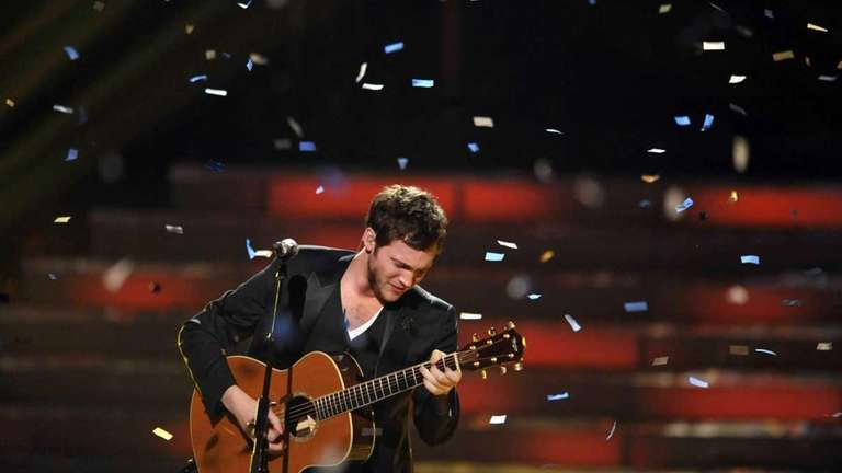 Winner Phillip Phillips performs onstage during the American