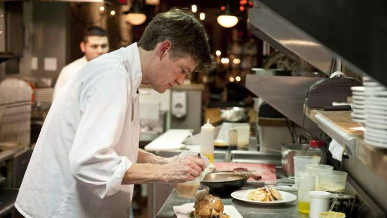 Chef Jeffery Slade plating a dish at The