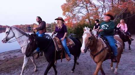 Horseback riders from Babylon Riding Center, take a