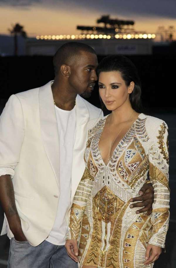 Singer Kanye West, left, and television personality Kim