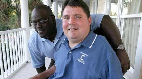 Former Citadel football player Marc Buoniconti, right, who,