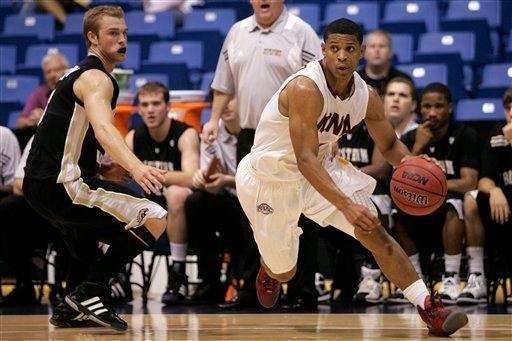 Iona's Scott Machado, right, dribbles past Western Michigan's