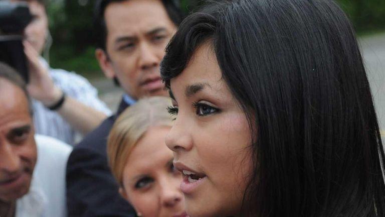Jessica Barba talks to reporters outside the Longwood