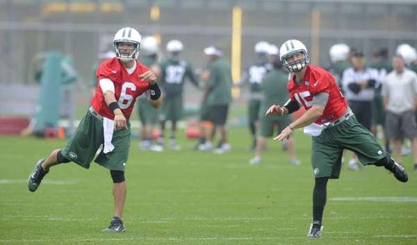 Jets quarterbacks Mark Sanchez, left, and Tim Tebow