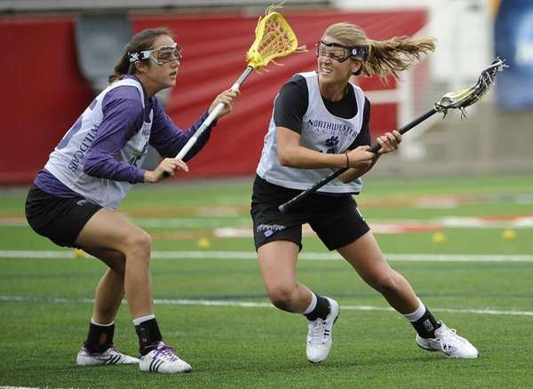 Northwestern's Lacey Vigmostad (Northport), right, is defended by