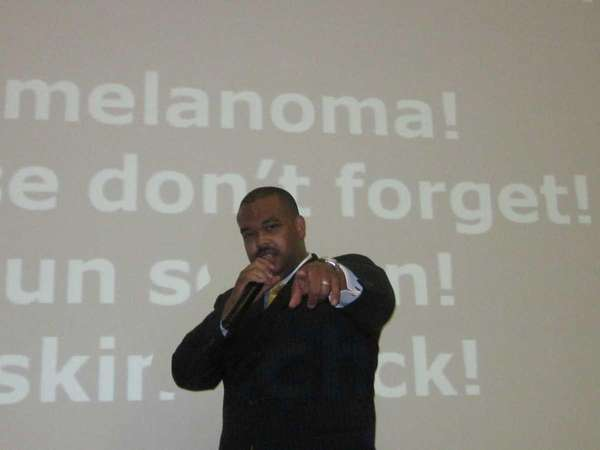 Dr. John Clarke raps for students at Garden