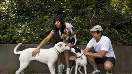 DogVacay host and home owner Tracie Sorrentini holds