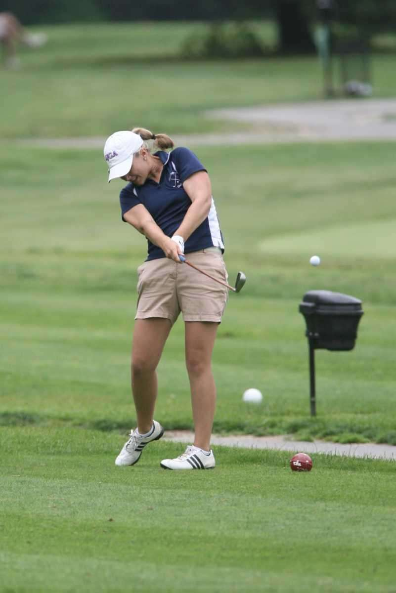 Northport's Krissy Unger tees off during the Suffolk