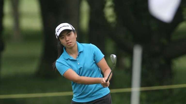 Mt. Sinai's Kristine Ly chips a shot during