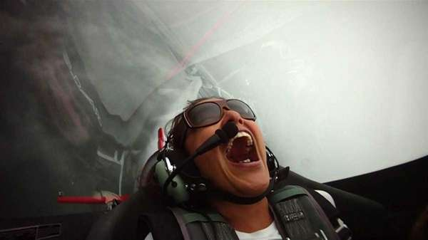 Newsday reporter Tania Lopez aboard a two-seat, single-wing