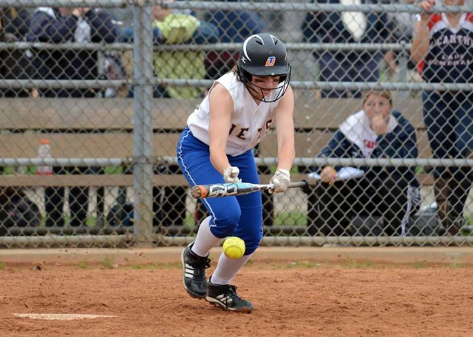 East Meadow's Claire Travis lays down a bunt