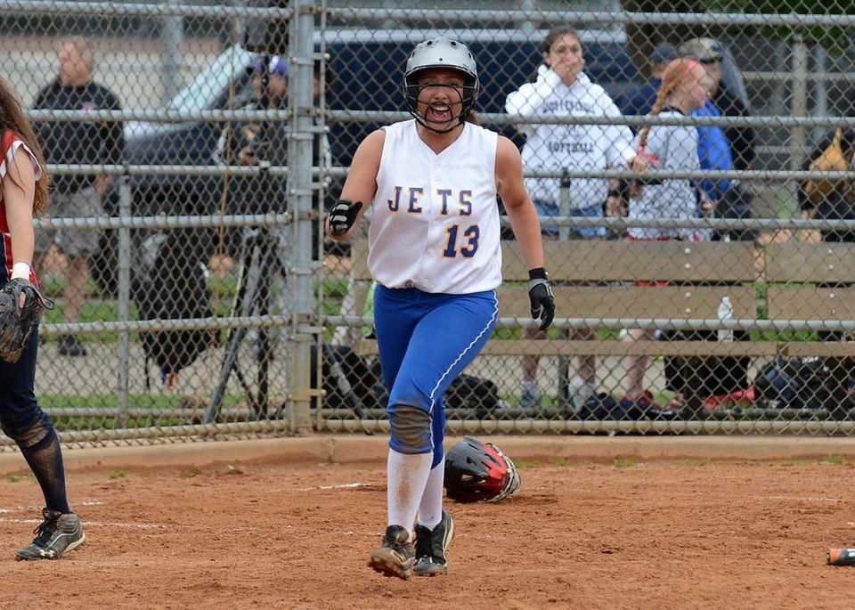 East Meadow's Dina LaRosa scores the winning run