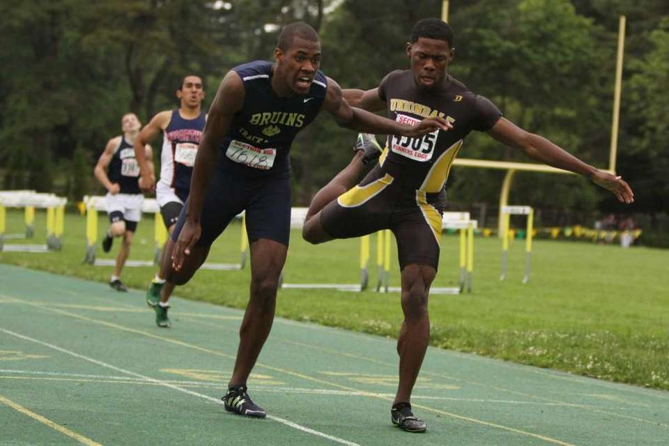 Baldwin's Kirk Staine, left, edges out Uniondale's Tresean