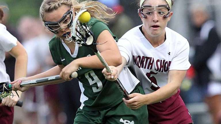 Seaford's Emily Palermo competes for the ball against
