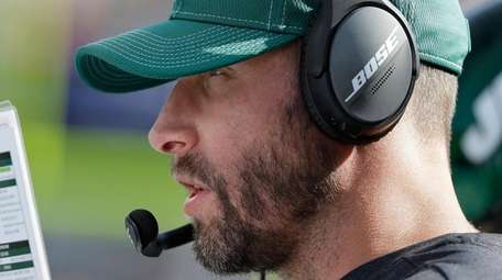 Jets head coach Adam Gase watches from the