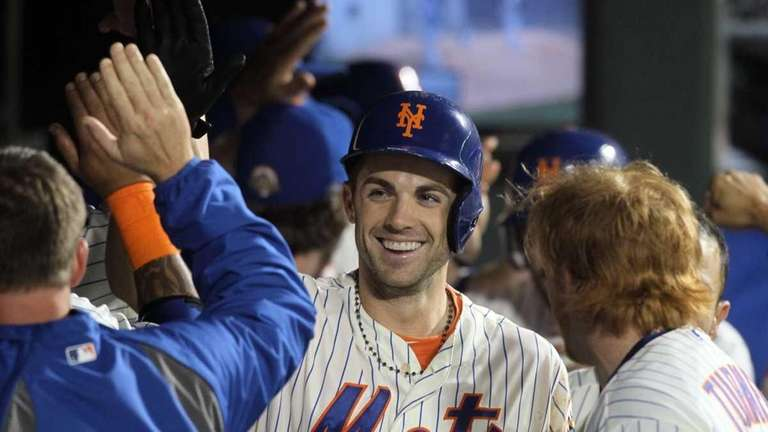 David Wright celebrates his sixth inning two-run home