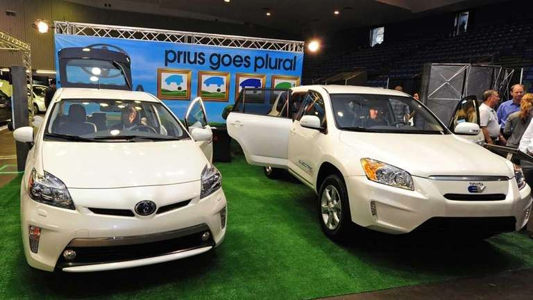 Visitors view the Toyota Prius PHV (plug-in hybrid