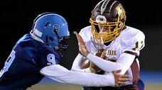 Kings Park quarterback Mike Ingraffia picks up six