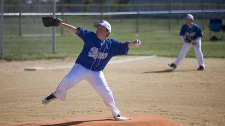 Thomas Colamartino, 11, pitches in the first game