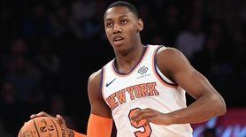 The Knicks' RJ Barrett dribbles the ball up