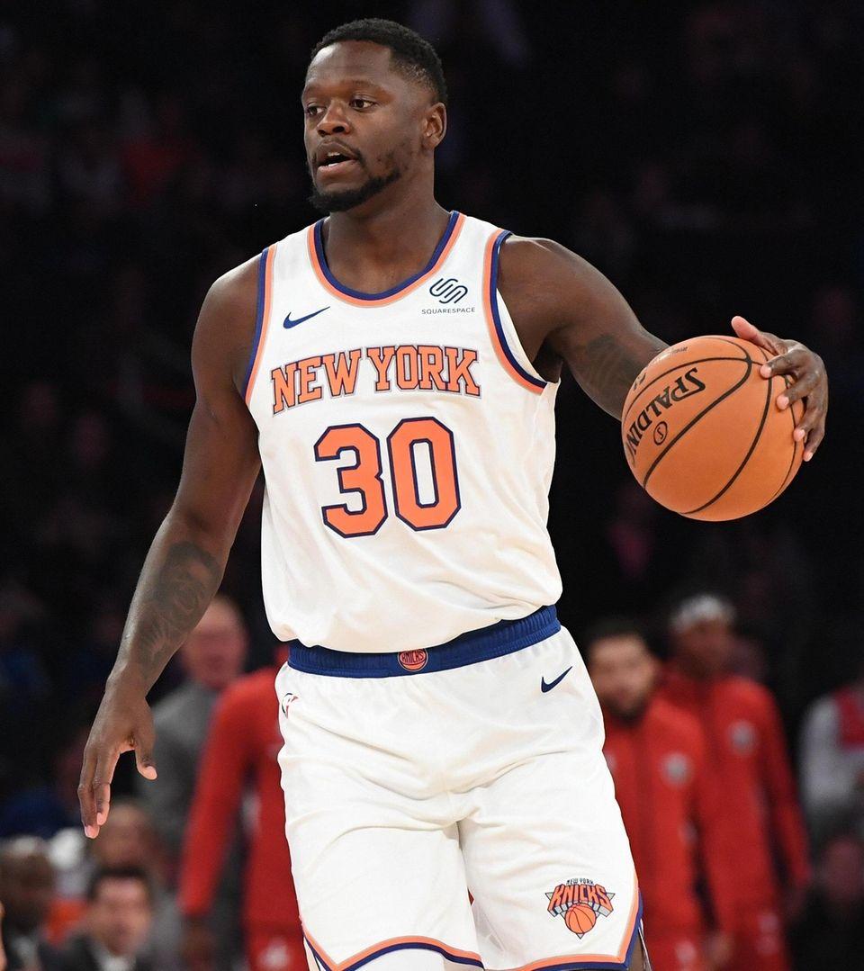 New York Knicks forward Julius Randle dribbles the
