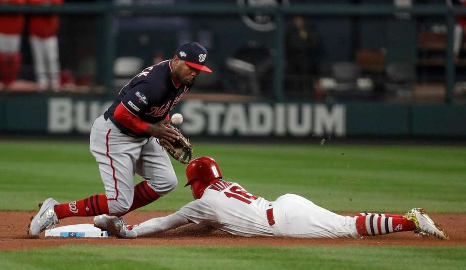 Washington Nationals' Howie Kendrick can't handle the throw