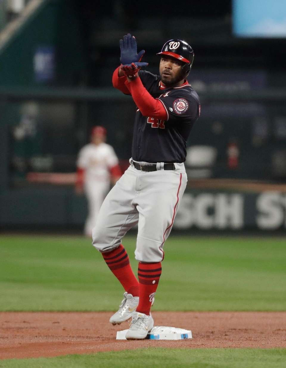 Washington Nationals' Howie Kendrick reacts after his double