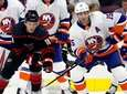 Carolina Hurricanes' Ryan Dzingel (18) battles with Islanders'