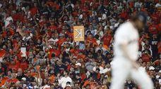 Fans react after Houston Astros pitcher Gerrit Cole