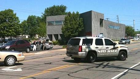 Police surround a real estate office in Valpariso,