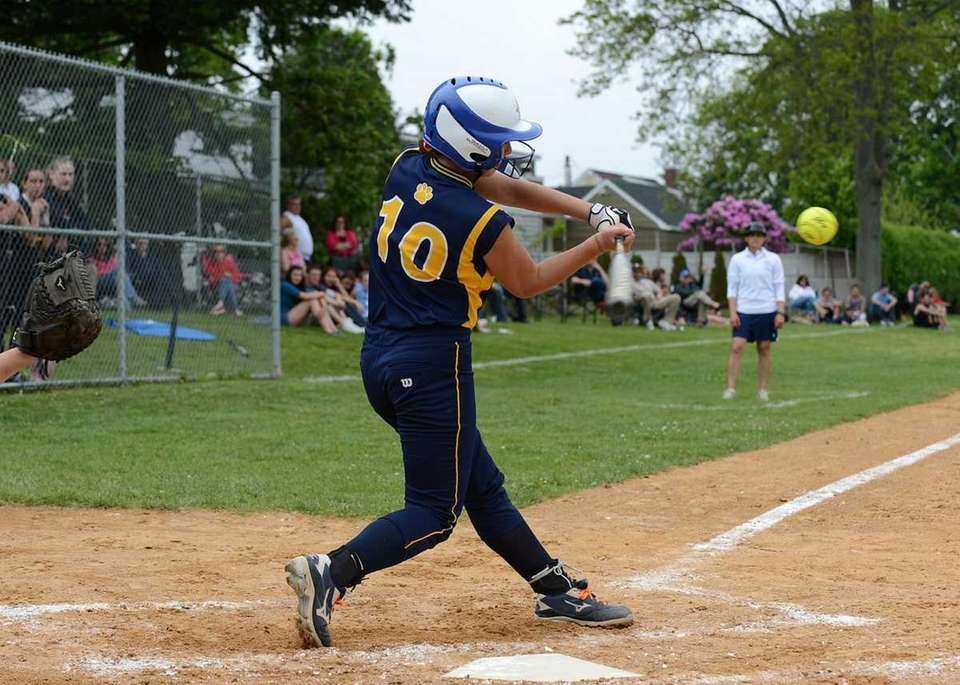 Shoreham's Madeline Massa connects for a hit during