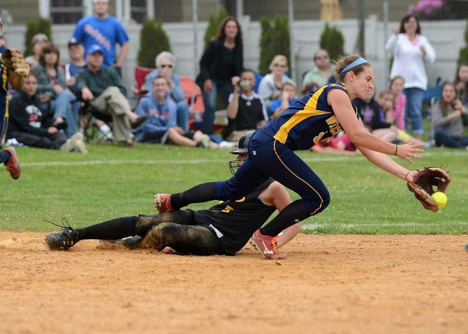 Sayville's Maria Slager beats the throw and tag