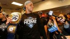 Aaron Judge holds the championship belt before awarding