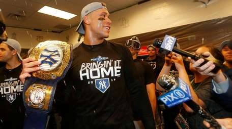 Aaron Judge holds the championship belt before awarding