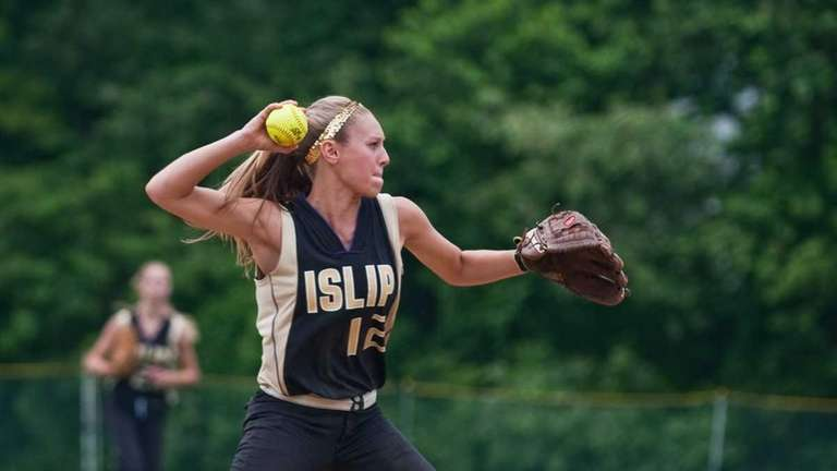 Islip's Kayla Jurka throws for an out during