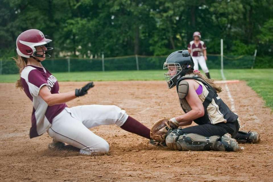 East Hampton's Casey Waleko slides into Islip's Faith