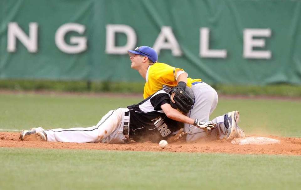 St. Anthony's Michael Gentile, left, collides with Kellenberg's