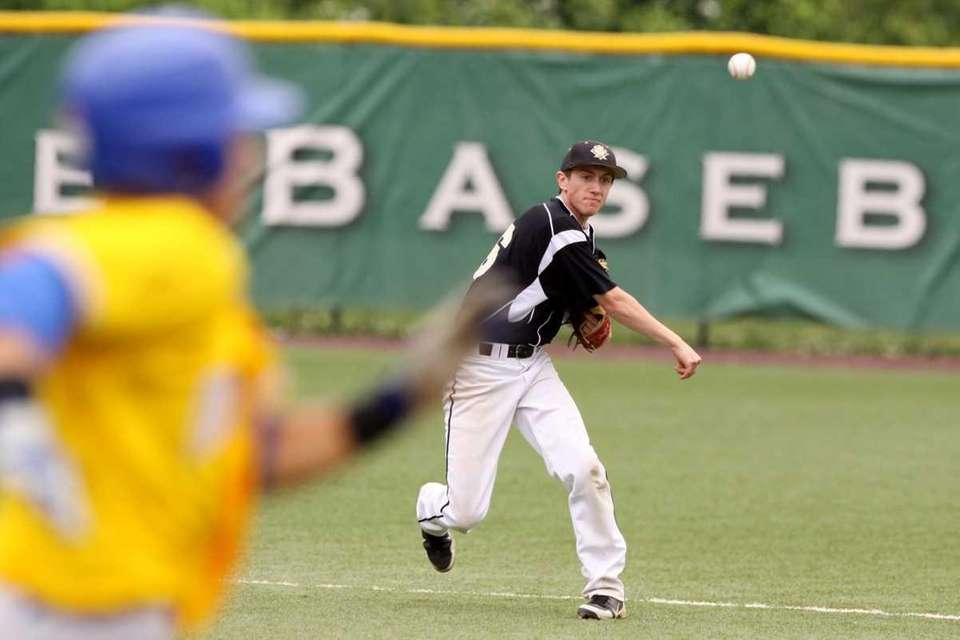 St. Anthony's Michael Gentile throws to first as